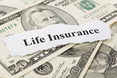 image of life insurance sign on top of money
