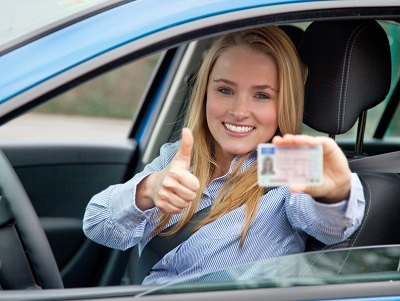 image of woman giving thumbs up to point free license