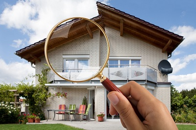 image of house through magnifying glass